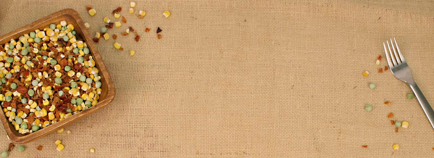 Food storage background of dried peas, carrots, and corn.
